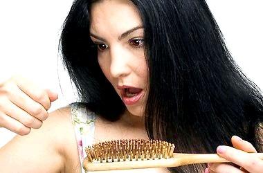 Як зупинити випадіння волосся? фото